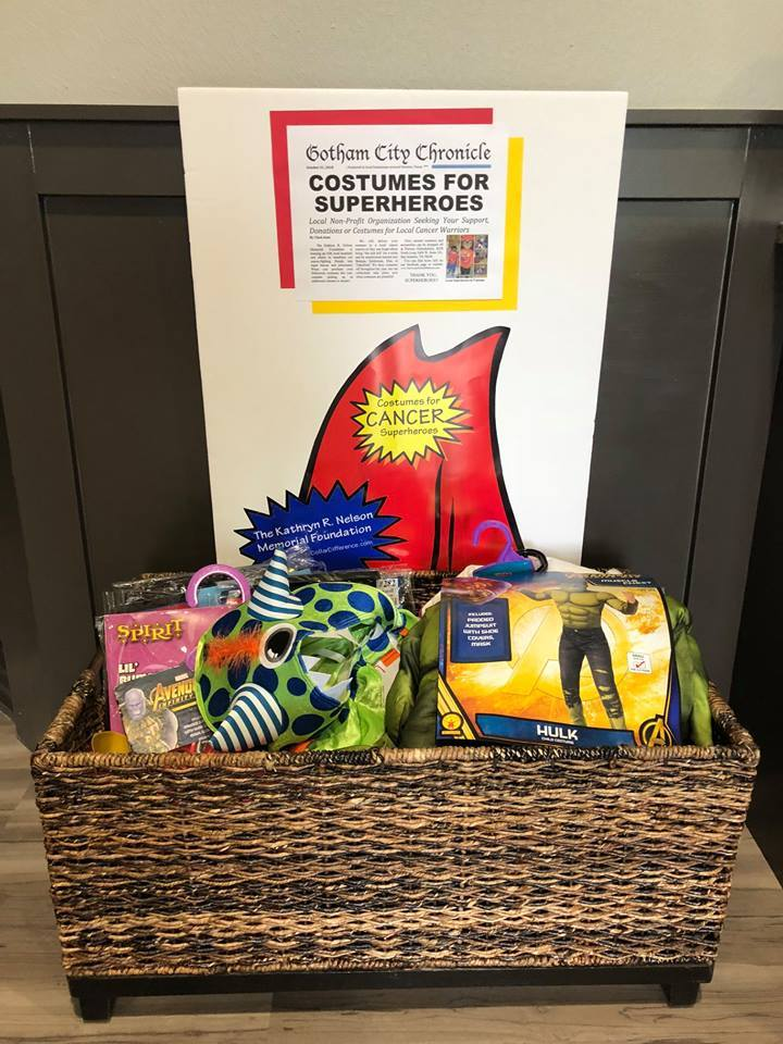 Basket of donated costumes for cancer patients